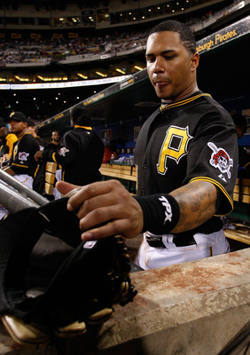 PITTSBURGH - SEPTEMBER 21:  Jose Tabata #31 of the Pittsburgh Pirates grabs his hat and glove before heading out onto the field during the game against the St. Louis Cardinals on September 21, 2010 at PNC Park in Pittsburgh, Pennsylvania.  (Photo by Jared
