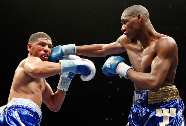 LAS VEGAS - APRIL 11:  Paul Williams (R) hits Winky Wright in the eighth round of their middleweight bout at the Mandalay Bay Events Center April 11, 2009 in Las Vegas, Nevada. Williams won by unanimous decision.  (Photo by Ethan Miller/Getty Images)