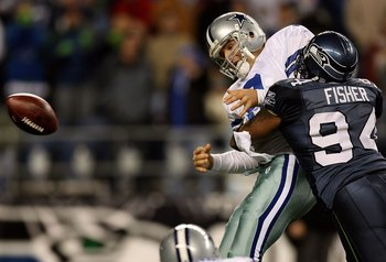 SEATTLE - JANUARY 06:  Quarterback Tony Romo #9 of the Dallas Cowboys is taken down by Bryce Fisher #94 of the Seattle Seahawks near the Cowboys goal line in the second half of the NFC Wild Card Playoff Game on January 6, 2007 at Qwest Field in Seattle, W