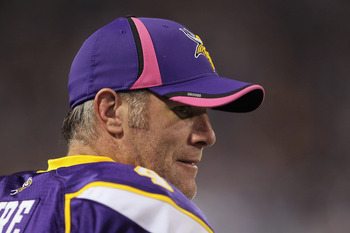 MINNEAPOLIS - OCTOBER 17:  Quarterback Brett Favre #4 of the Minnesota Vikings looks on during the game against the Dallas Cowboys at Mall of America Field on October 17, 2010 in Minneapolis, Minnesota. The Vikings defeated the Cowboys 24-21.  (Photo by J