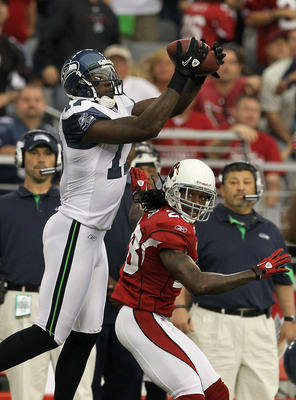 GLENDALE, AZ - NOVEMBER 14:  Wide receiver Mike Williams #17 of the Seattle Seahawks makes a catch over cornerback Greg Toler #28 of the Arizona Cardinals at University of Phoenix Stadium on November 14, 2010 in Glendale, Arizona. Seattle won 36-18.  (Pho