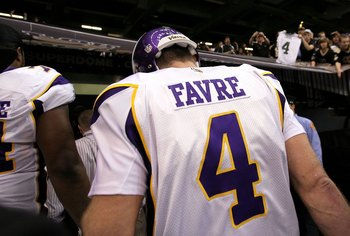 NEW ORLEANS - JANUARY 24:  A fan in the stands holds up a Green Bay Packers #4 jersey as Brett Favre #4 of the Minnesota Vikings walks off the field after the Vikings lost to the New Orleans Saints 31-28 in overtime during the NFC Championship Game at the