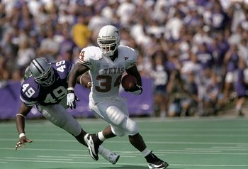 19 Sep 1998:  Tailback Ricky Williams #34 of the Texas Longhorns runs with the ball while being pursued by Darren Howard #49 of the Kansas State Wildcats during a game at the KSU Wagner Field in Manhattan, Kansas. The Wildcats defeated the Longhorns 48-7.