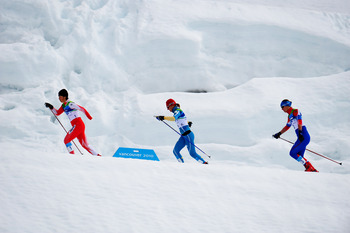 WHISTLER, BC - MARCH 21:  (L-R) Shoko Ota of Japan, Oleksandra Kononova of Ukraine and Anna Burmistrova of Russia compete in the Women's 1km Standing Cross-Country Sprint Final during Day 10 of the 2010 Vancouver Winter Paralympics at Whistler Paralympic