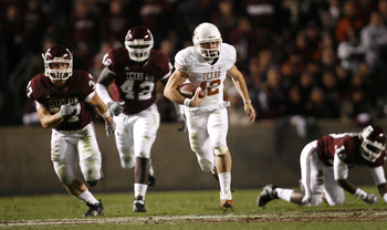 COLLEGE STATION, TX - NOVEMBER 26: Quarterback Colt McCoy #12 of the Texas Longhorns scrambles away from the Texas A&M Aggies defense to score a touchdown in the first half at Kyle Field on November 26, 2009 in College Station, Texas.  (Photo by Aaron M.