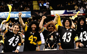 NEW ORLEANS - OCTOBER 31:  Fans dressed as Troy Polamalu #43 of the Pittsburgh Steelers pump their fist during the game against the New Orleans Saints at Louisiana Superdome on October 31, 2010 in New Orleans, Louisiana.  The Saints won 20-10 over the Ste