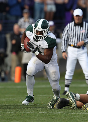 EVANSTON, IL - OCTOBER 23: Edwin Baker #4 of the Michigan State Spartans runs against the Northwestern Wildcats at Ryan Field on October 23, 2010 in Evanston, Illinois. Michigan State defeated Northwestern 35-27. (Photo by Jonathan Daniel/Getty Images)