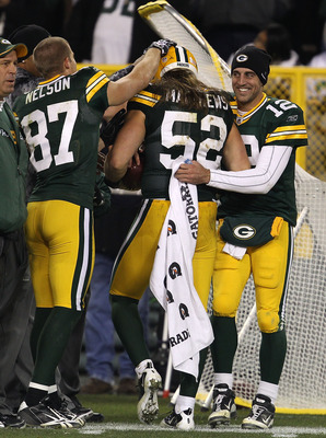 GREEN BAY, WI - NOVEMBER 07: Clay Matthews #52 of the Green Bay Packers is congratulated by teammates Jordy Nelson #87 and Aaron Rodgers #12 after scoring a touchdown against the Dallas Cowboys at Lambeau Field on November 7, 2010 in Green Bay, Wisconsin.