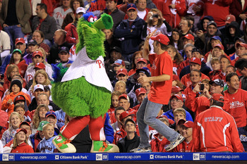 PHILADELPHIA - OCTOBER 16:  The Phillie Phanatic performs with a male performer during Game One of the NLCS during the 2010 MLB Playoffs between the Philadelphia Phillies and the San Francisco Giants at Citizens Bank Park on October 16, 2010 in Philadelph