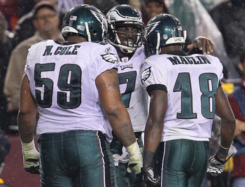 LANDOVER, MD - NOVEMBER 15:  Michael Vick #7 of the Philadelphia Eagles celebrates his second touchdown with team mates Nick Cole #59 and Jeremy Maclin #18 against the Washington Redskins on November 15, 2010 at FedExField in Landover, Maryland.  (Photo b