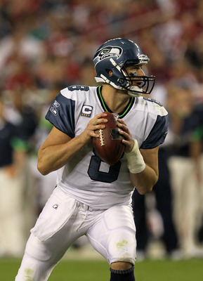 GLENDALE, AZ - NOVEMBER 14:  Quarterback Matt Hasselbeck #8 of the Seattle Seahawks drops back to pass with his left wrist wrapped after injuring it in the game with the Arizona Cardinals at University of Phoenix Stadium on November 14, 2010 in Glendale,