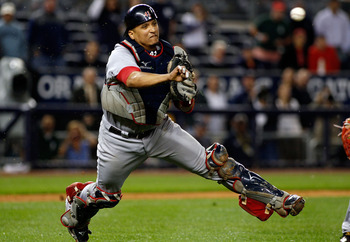 NEW YORK - SEPTEMBER 26:  Victor Martinez #41 of the Boston Red Sox throws the ball away for an error on Brett Gardner (not shown) of the New York Yankees bunt attempt in the 10th inning on September 26, 2010 at Yankee Stadium in the Bronx borough of New