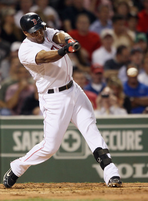 BOSTON - SEPTEMBER 22:  Adrian Beltre #29 of the Boston Red Sox hits a single in the second inning against the Baltimore Orioles on September 22, 2010 at Fenway Park in Boston, Massachusetts.  (Photo by Elsa/Getty Images)