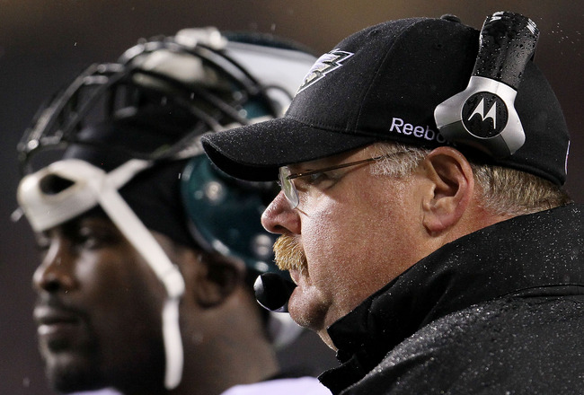 LANDOVER, MD - NOVEMBER 15: Head coach Andy Reid of the Philadelphia Eagles and quarterback   Michael Vick #7  wait for a review to be completed against  the Washington Redskins on November 15, 2010 at FedExField in Landover, Maryland.  (Photo by Chris Mc
