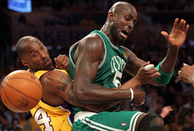 LOS ANGELES, CA - JUNE 15:  Kevin Garnett #5 of the Boston Celtics and Kobe Bryant #24 of the Los Angeles Lakers battle for the ball in the first period of Game Six of the 2010 NBA Finals at Staples Center on June 15, 2010 in Los Angeles, California.  NOT