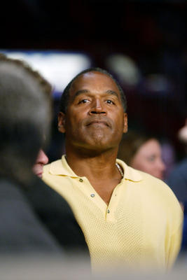 02 Feb 2002:   OJ Simpson observes during the Lightheavyweight bout between Roy Jones Jr and Glen Kelly at American Airlines Arena in Miami, Florida. Roy Jones Jr. won by KO in the 7th. DIGITAL IMAGE. Mandatory Credit: Eliot Schechter/Getty Images