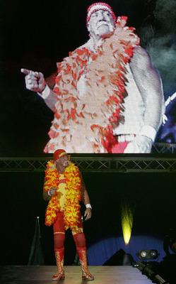 PERTH, AUSTRALIA - NOVEMBER 24:  Hulk Hogan enters the stage prior to his bout against Rick Flair during the Hulkamania Tour at the Burswood Dome on November 24, 2009 in Perth, Australia.  (Photo by Paul Kane/Getty Images)