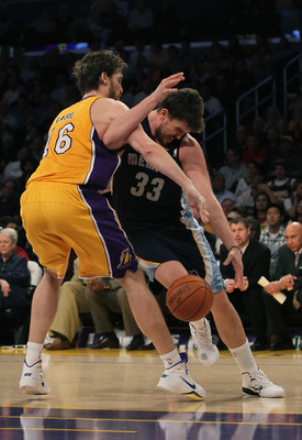 LOS ANGELES, CA - NOVEMBER 02:  Marc Gasol #33 of the Memphis Grizzlies is fouled by Pau Gasol #16 of the Los Angeles Lakers during the second quarter at Staples Center on November 2, 2010 in Los Angeles, California. The Lakers defeated the Grizzlies 124-
