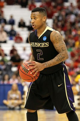 SYRACUSE, NY - MARCH 25:  Isiah Thomas #2 of the Washington Huskies looks to pass the ball against the West Virginia Mountaineers during the east regional semifinal of the 2010 NCAA men's basketball tournament at the Carrier Dome on March 25, 2010 in Syra