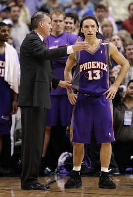 DALLAS, TX - MAY 20: Head coach Mike D'Antoni talks with Steve Nash #13 of the Pheonix Suns in overtime against the Dallas Mavericks in Game six of the Western Conference Semi-finals during the 2005 NBA Playoffs at the American Airlines Center on May 20,