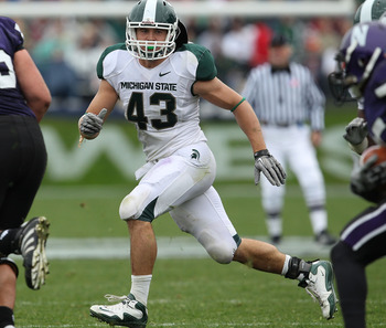 EVANSTON, IL - OCTOBER 23: Eric Gordon #43 of the Michigan State Spartans follows a play against the Northwestern Wildcats at Ryan Field on October 23, 2010 in Evanston, Illinois. Michigan State defeated Northwestern 35-27. (Photo by Jonathan Daniel/Getty