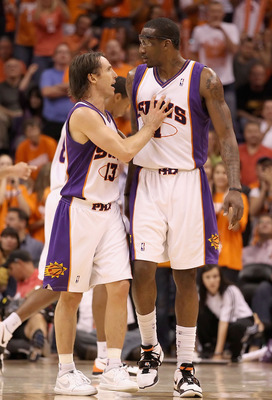 PHOENIX - MAY 03:  Steve Nash #13 and Amar'e Stoudemire #1 of the Phoenix Suns talk during Game One of the Western Conference Semifinals of the 2010 NBA Playoffs against the San Antonio Spurs at US Airways Center on May 3, 2010 in Phoenix, Arizona. The Su