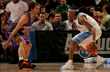 DENVER - MARCH 17:   Allen Iverson #3 of the Denver Nuggets controls the ball as Steve Nash #13 of the Phoenix Suns defends during NBA action at the Pepsi Center on March 17, 2007 in Denver, Colorado. NOTE TO USER: User expressly acknowledges and agrees t