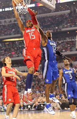 ARLINGTON, TX - FEBRUARY 14:  Carmelo Anthony #15 of the Western Conference shoots against Dwight Howard #12 of the Eastern Conference during the first quarter of the NBA All-Star Game, part of 2010 NBA All-Star Weekend at Cowboys Stadium on February 14,