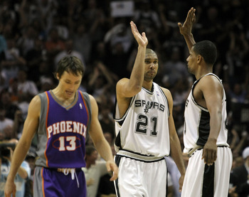 SAN ANTONIO - APRIL 29:  Tim Duncan #21 of the San Antonio Spurs celebrates in the final seconds with teammate Kurt Thomas #40 in front of Steve Nash #13 of the Phoenix Suns on way to a 92-87 win and a 4-1 series win in Game Five of the Western Conference