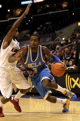 LOS ANGELES, CA - MARCH 11:  Malcolm Lee #3 of the UCLA Bruins drives arouund Kyle Fogg #21 of the Arizona Wildcats during the quarterfinals of the Pac-10 Basketball Tournament at Staples Center on March 11, 2010 in Los Angeles, California. UCLA won 75-69