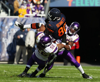 CHICAGO - NOVEMBER 14: E.J. Henderson #56 and Husain Abdullah #39 of the Minnesota Vikings tackle Earl Bennett #80 of the Chicago Bears at Soldier Field on November 14, 2010 in Chicago, Illinois. The Bears defeated the Vikings 27-13. (Photo by Jonathan Da