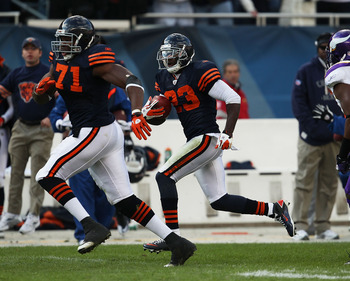 CHICAGO - NOVEMBER 14: Devin Hester #23 of the Chicago Bears follows Israel Idonije #71 while returning a kick-off against the Minnesota Vikings at Soldier Field on November 14, 2010 in Chicago, Illinois. The Bears defeated the Vikings 27-13. (Photo by Jo