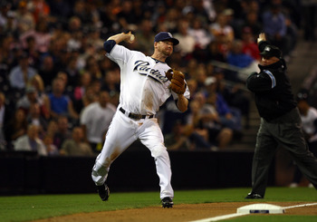 SAN DIEGO, CA - SEPTEMBER 10:  3rd Baseman Chase Headley #7 of the San Diego Padres fields the ball for an out against the San Francisco Giants during their MLB game on September 10, 2010 at Petco Park in San Diego, California. (Photo by Donald Miralle/Ge