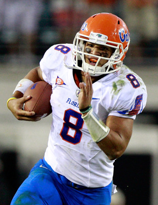 JACKSONVILLE, FL - OCTOBER 30:  Trey Burton #8 of the Florida Gators runs for yardage against the Georgia Bulldogs during the game at EverBank Field on October 30, 2010 in Jacksonville, Florida.  (Photo by Sam Greenwood/Getty Images)