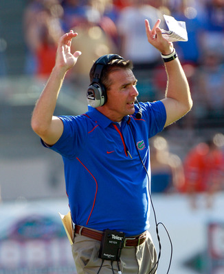 JACKSONVILLE, FL - OCTOBER 30:  Head coach Urban Meyer of the Florida Gators watches the action during the game against the Georgia Bulldogs at EverBank Field on October 30, 2010 in Jacksonville, Florida.  (Photo by Sam Greenwood/Getty Images)