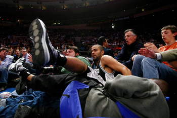 NEW YORK - FEBRUARY 17: Tony Parker #9 of the San Antonio Spurs crashes into photographers and the crowd against the New York Knicks at Madison Square Garden February 17, 2009 in New York City. NOTE TO USER: User expressly acknowledges and agrees that, by
