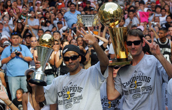 SAN ANTONIO - JUNE 17:  Tony Parker #9 (L) and Brent Barry #17 of the San Antonio Spurs waves to the fans during the NBA championship parade down the San Antonio River walk June 17, 2007 in San Antonio, Texas. NOTE TO USER: User expressly acknowledges and