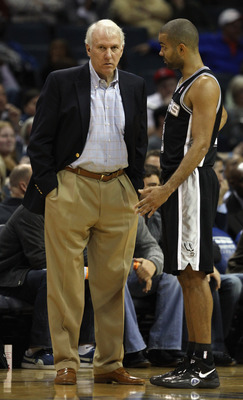 CHARLOTTE, NC - NOVEMBER 08:  Head coach Gregg Popovich and Tony Parker #9 of the San Antonio Spurs talk to eachother during their game against the Charlotte Bobcats at Time Warner Cable Arena on November 8, 2010 in Charlotte, North Carolina.  NOTE TO USE