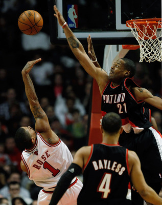 CHICAGO - FEBRUARY 26: Marcus Camby #21 of the Portland Trail Blazers blocks a shot by Derrick Rose #1 of the Chicago Bulls at the United Center on February 26, 2010 in Chicago, Illinois. NOTE TO USER: User expressly acknowledges and agrees that, by downl