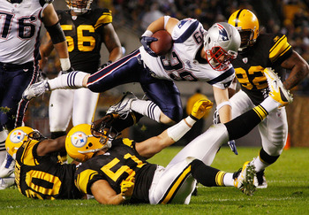 PITTSBURGH - NOVEMBER 14:  Danny Woodhead #39 of the New England Patriots jumps over James Farrior #51 of the Pittsburgh Steelers during the game on November 14, 2010 at Heinz Field in Pittsburgh, Pennsylvania.  (Photo by Jared Wickerham/Getty Images)