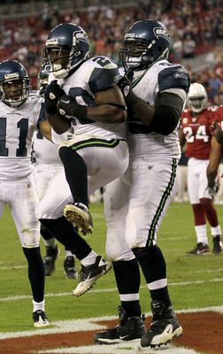GLENDALE, AZ - NOVEMBER 14:  Running back Justin Forsett #20 of the Seattle Seahawks is lifted by center Chris Spencer #65 as they celelbrate his four yard touchdown carry against the Arizona Cardinals in the fourth quarter at University of Phoenix Stadiu