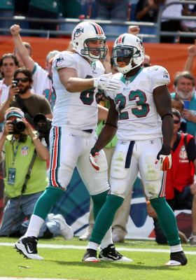 MIAMI - NOVEMBER 14:  Running Back Ronnie Brown #23 of the Miami Dolphins celebrates a touchdown with teammate Anthony Fasano #80 against the Tennessee Titans at Sun Life Stadium on November 14, 2010 in Miami, Florida.  (Photo by Marc Serota/Getty Images)