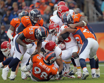 DENVER - NOVEMBER 14:  Running back Thomas Jones #20 of the Kansas City Chiefs is stopped by the Denver Bronco defense at INVESCO Field at Mile High on November 14, 2010 in Denver, Colorado.  (Photo by Doug Pensinger/Getty Images)