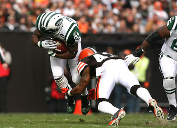 CLEVELAND - NOVEMBER 14:  Running back LaDainian Tomlinson #21 of the New York Jets is hit by defensive back T.J. Ward #43  of the Cleveland Browns  at Cleveland Browns Stadium on November 14, 2010 in Cleveland, Ohio.  (Photo by Matt Sullivan/Getty Images