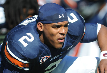 AUBURN, AL - NOVEMBER 06:  Quarterback Cam Newton #2 of the Auburn Tigers stretches before play against the Chattanooga Mocs November 6, 2010 at Jordan-Hare Stadium in Auburn, Alabama.  (Photo by Al Messerschmidt/Getty Images)