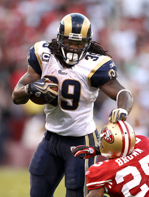 SAN FRANCISCO - NOVEMBER 14:  Steven Jackson #39 of the St. Louis Rams pushes Tarell Brown #25 of the San Francisco 49ers at Candlestick Park on November 14, 2010 in San Francisco, California.  (Photo by Ezra Shaw/Getty Images)