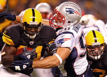 PITTSBURGH - NOVEMBER 14:  Rashard Mendenhall #34 of the Pittsburgh Steelers is tackled by Rob Ninkovich #50 of the New England Patriots during the game on November 14, 2010 at Heinz Field in Pittsburgh, Pennsylvania.  (Photo by Jared Wickerham/Getty Imag