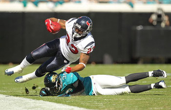 JACKSONVILLE, FL - NOVEMBER 14:  Arian Foster #23 of the Houston Texans is tackled by Courtney Greene #36 during a game against the Jacksonville Jaguars at EverBank Field on November 14, 2010 in Jacksonville, Florida.  (Photo by Mike Ehrmann/Getty Images)