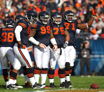 CHICAGO - NOVEMBER 14: Members of the Chicago Bear defense including (L-R) Julius Peppers #90, Marcus Harrison #99, Matt Toeaina #75 and Israel Idonije #71 await the start of play against the Minnesota Vikings at Soldier Field on November 14, 2010 in Chic