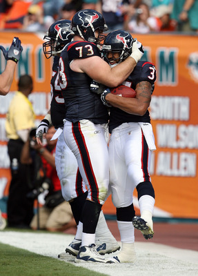 MIAMI - DECEMBER 27:  Running back Arian Foster #37 of the Houston Texans celebrates his touchdown run with offensive lineman Eric Winston #73 while taking on the Miami Dolphins at Land Shark Stadium on December 27, 2009 in Miami, Florida.  (Photo by Doug